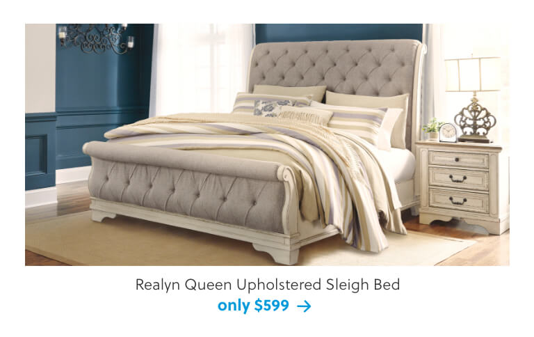Realyn Queen Upholstered Sleigh Bed