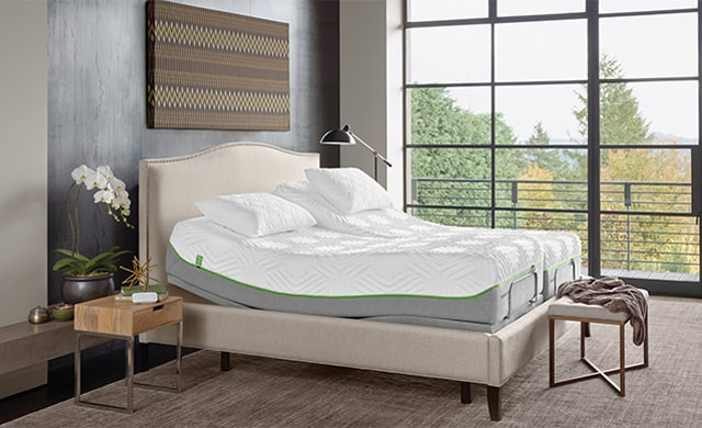 tan bed with tilted mattress