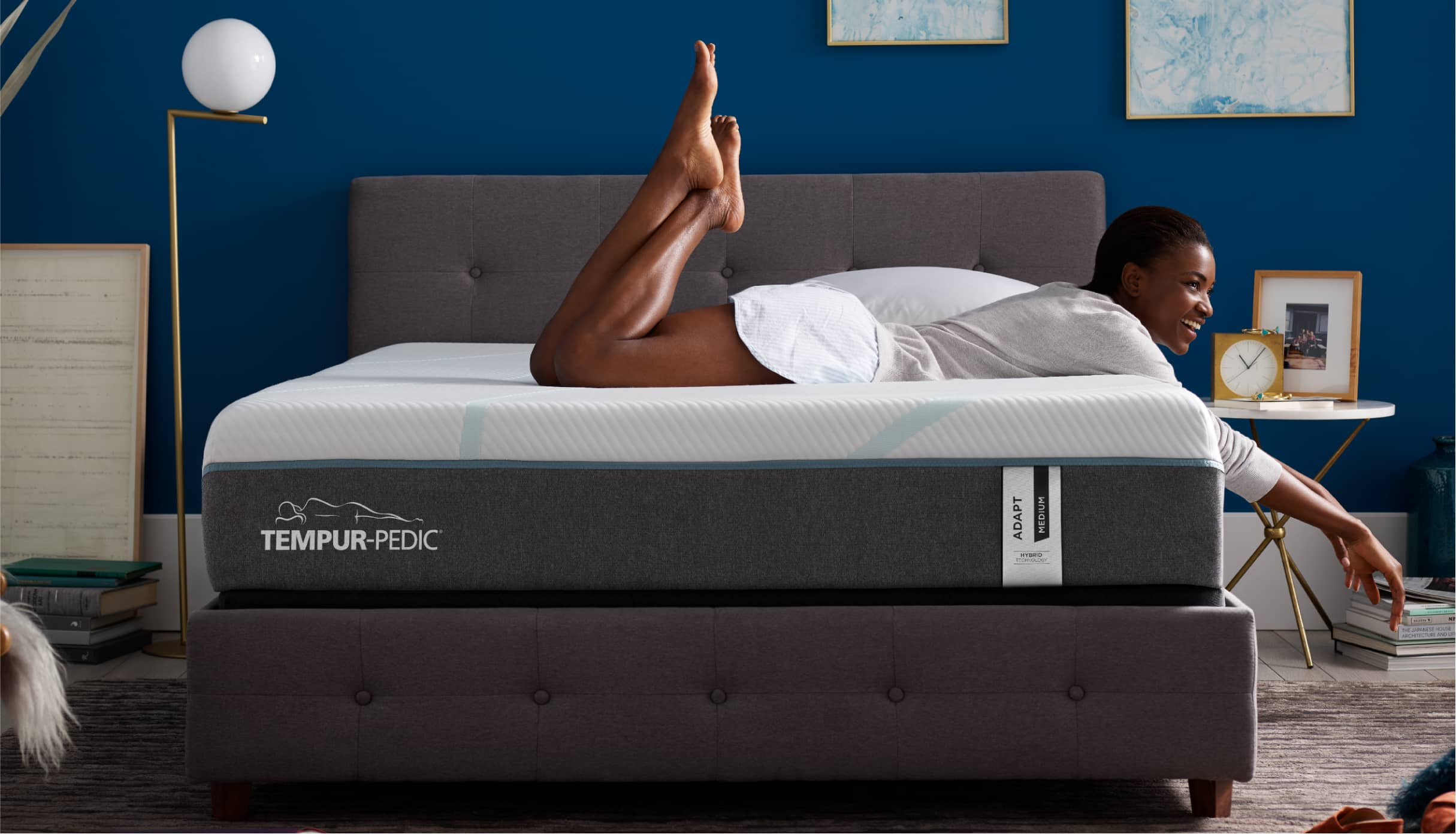 Woman laying on a Tempur-Pedic<sup>&reg;</sup> mattress.